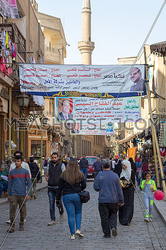 Cairo, Egypt - March 10, 2018: Banners supporting current Egyptian president Abdel-Fattah El-Sisi for a second term for the presidential elections at crowded Al Moez Street, Gamalia district