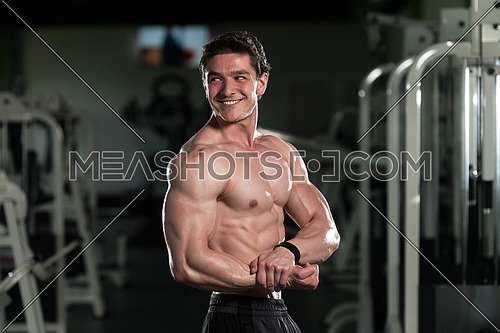 Bodybuilder Posing In Different Poses Demonstrating Their Muscles - Male Showing Muscles Straining - Beautiful Muscular Body Athlete