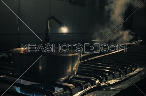 Grilled Meat and Chicken on a Stove