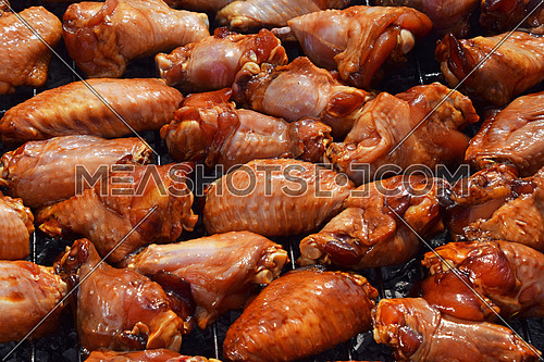 Chicken buffalo or teriyaki sauce raw wings cooked grilled on bbq smoke grill