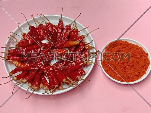 spicy and hot Red Dry Red Chilli stock and powder on bowl