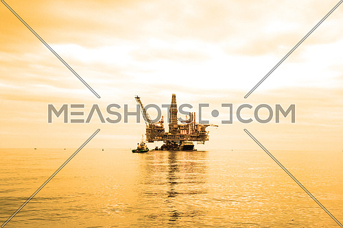 Oil Rig during sunset hours