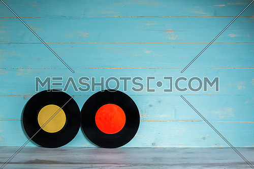 Two vinyl records on wooden background,vintage style