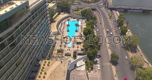 Pedestal shot Drone for Nile Ritz Carlton Hotel showing Kasr Al Nile Bridge in Cairo Downtown at Day