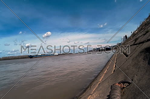 Danube river timelaps with moving clouds in the sky