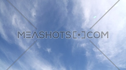 Slow flying and rotation of cloudy blue day sky