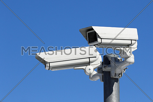 CCTV Security Video Cameras mounted on metal pole