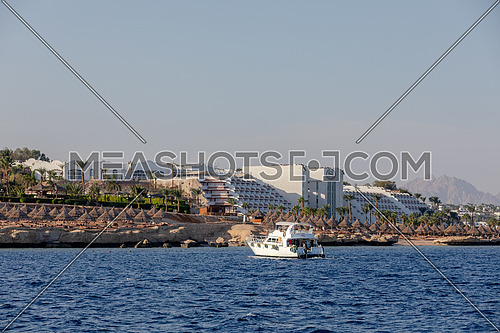 Long shot for yacht sailing showing Sheraton Hotel in Sharm El Shaikh City by day