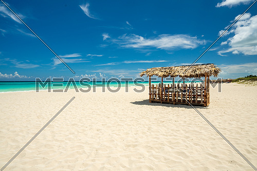 Awesome beach of Varadero during the day,in the middle a wooden and straw tent for massages on the beach, Varadero Cuba.