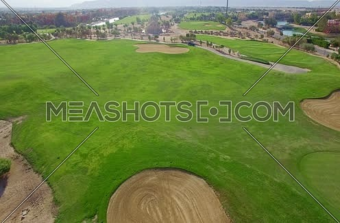 Drone shot flying above a golf course Al Gouna at Day