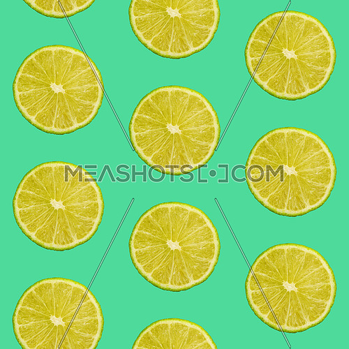Seamless pattern of fresh green lime round cut wedges on vivid teal background