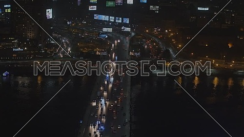 Ariel shot fly over Cairo City Near Tahrir Area showing traffic, 6th of October Bridge at night - Novermber 2018