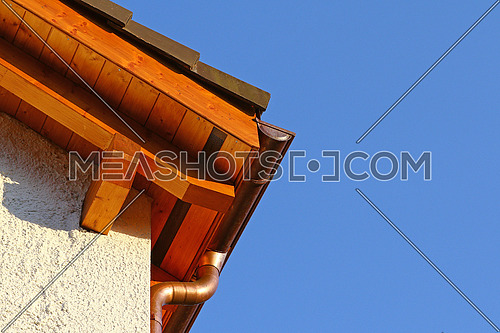 New roof top detail with ceramic tiles and copper water gutter