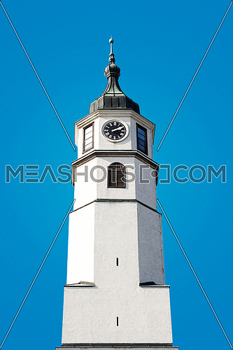 Tower Clock On Blue Background