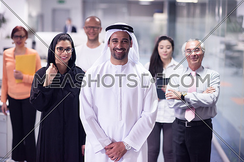 arabian businessmans make deal and handshake with company director at modern meeting room