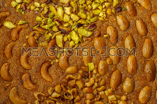 Oriental Ramadan sweets Basbosa with Almonds, Cashew, Pistacio and nuts