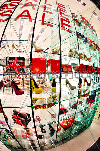 A woman shoe shop window with SALE signs
