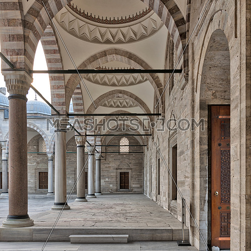 Passage leading to Sulaymaniye mosque, a public Ottoman Baroque style mosque, with columns, arches and marble floor, Fatih district, Istanbul, Turkey