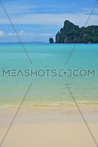 Tranquil seascape of tropical island sand beach, turquoise blue sea water and cloudy sky with horizon, summer day, low angle view