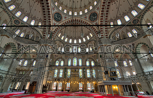 Istanbul, Turkey - April 21, 2017: Fatih Mosque, a public Ottoman mosque in the Fatih district with a huge decorated domes & many colored stained glass windows