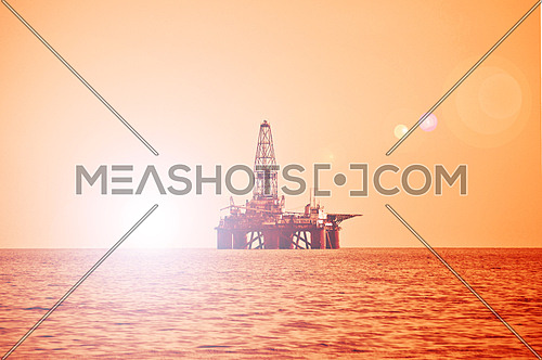 Offshore oil rig during sunset in Caspian sea
