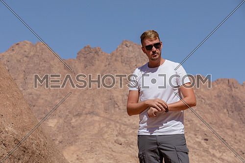 Long shot for a male tourist exploring Sinai Mountain for wadi Freij by day.