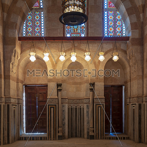 Marble wall with mihrab (niche), two wooden doors, huge arches and stained glass windows at mosque attached to Khayer Bek Mausoleum, Darb Al-Ahmar district, Old Cairo, Egypt