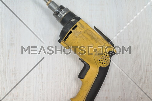 drill machine isolated on white old retro wood background