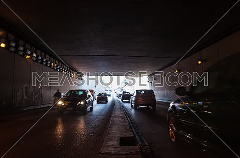 Fixed Shot for traffic from inside  Al Thawra Tunnel at Daytime