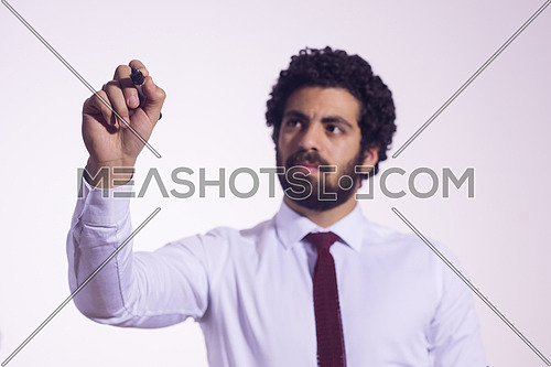 middle eastern business man writing with  marker on virtual screen isolated on white
