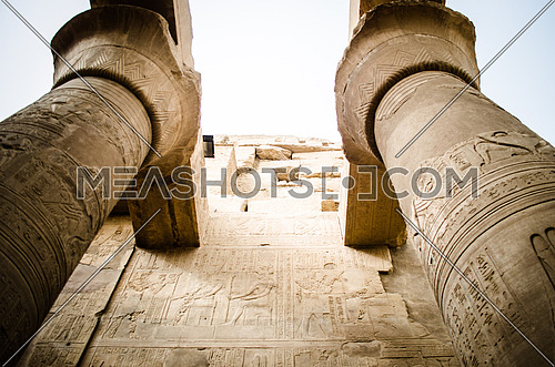 The top of a ceiling of Kom Ombo Pharaoh temple held on a huge columns decorated in a Papyrus shape at the top