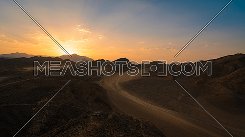 Wonderful landscape,Arabian desert of stone, Egypt with mountains at sunset.