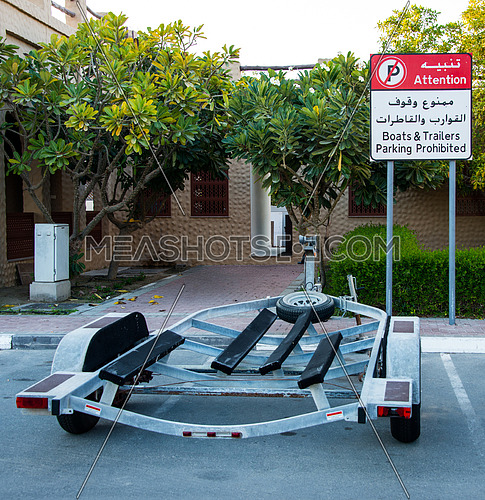 a boat trailer parked in a no trailer parking bay