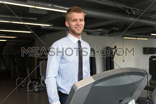 Businessman Running On Treadmill At A Health Club