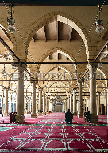 interior praying area in Amru ibn Elaas mosque in cairo Egypt with one man praying from behind