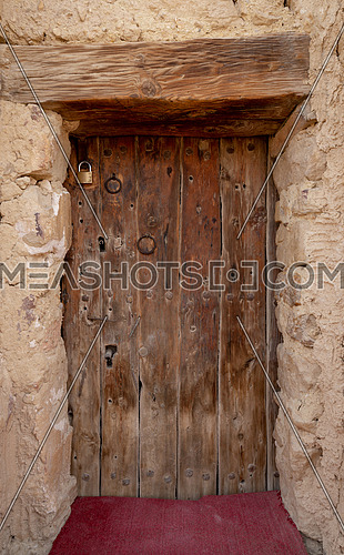Wooden door leading to the fort of Monastery of Saint Paul the Anchorite located in the Eastern Desert, near the Red Sea mountains, Egypt