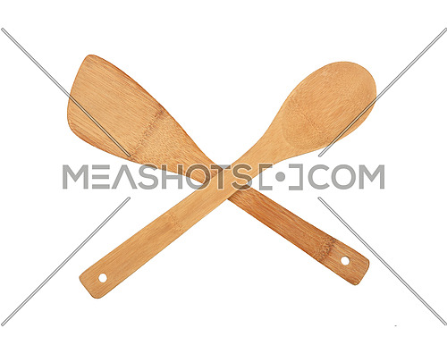 Close up one wooden spatula and one spoon crossed, natural cooking kitchen utensils of palm wood, isolated on white background, elevated top view, directly above