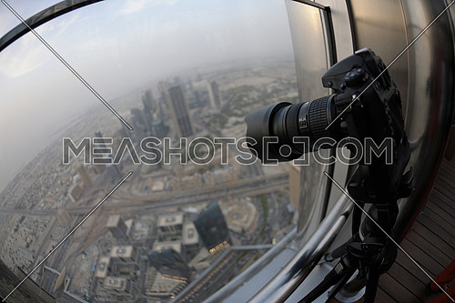Camera taking pictures of dubai city skyline main road and new skyscrapers at sunset