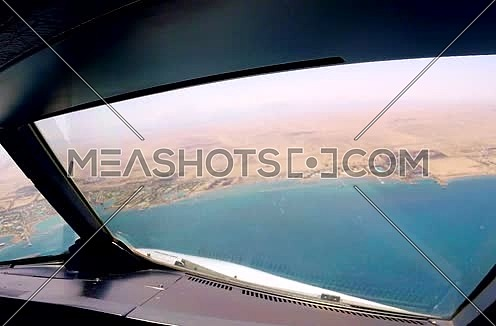Cockpit view for a air plane flying over Egypt Hurghada