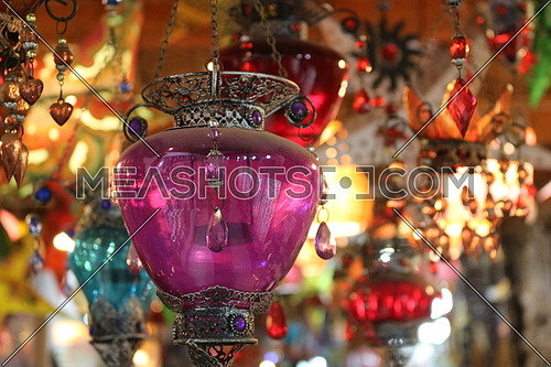 Purple oriental lantern hanging from ceiling