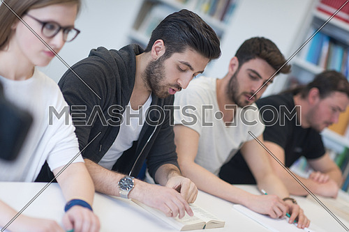 students group study together in school classroom and working together homework project