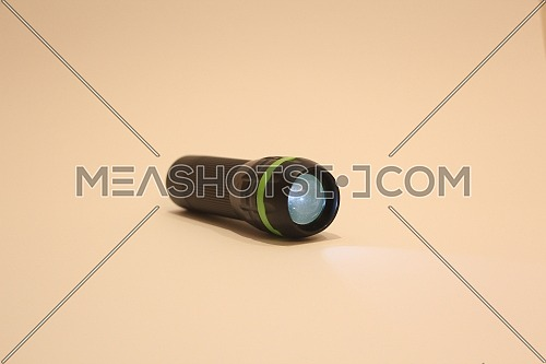Black with grean line flashlight on clear background