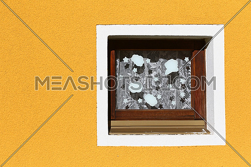 Small bathroom window with embroidered curtains