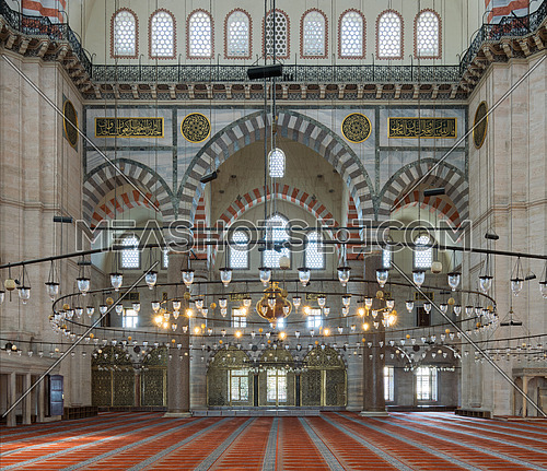 Interior of Suleymaniye Mosque, an Ottoman Baroque style mosque completed in 1755, with huge arches & many colored stained glass windows, Fatih district, Istanbul, Turkey