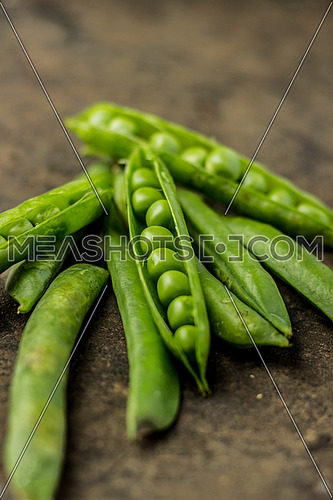 Raw Peas put on a table top