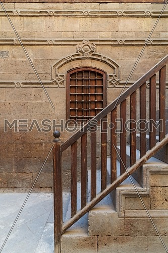 Wooden window and staircase with wooden balustrade leading to historic Beit El Set Waseela building (Waseela Hanem House), Old Cairo, Egypt
