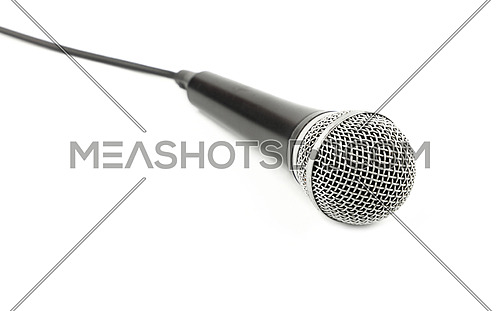 Black and silver vocal microphone with cable high angle side view close up isolated on white background, personal perspective