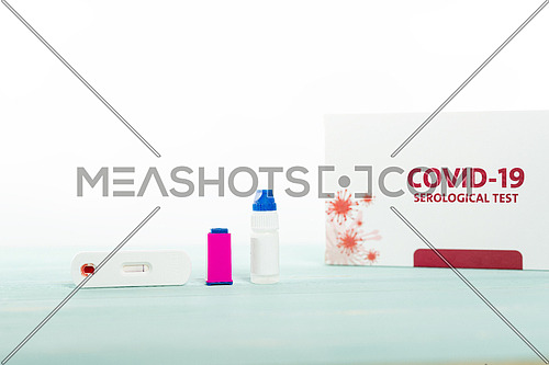 Coronavirus rapid self test for the detection of lgG and lgM antibodies against SARS-CoV.2, blood sample taken from patient's finger prick on cassette, Covid-19 rapid serological test procedure from home