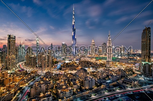 Extreme long shot for Dubai City showing Burj Khalifa by dusk