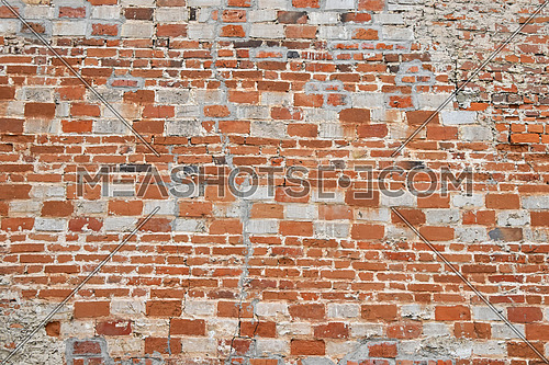 Antique wall texture of red and white bricks of different sizes